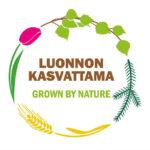 Logossa pyöreänä kehänä tulppaani, koivun ja männyn oksat ja viljan tähkä. Keskellä teksti Luonnon kasvattama Grown by nature.